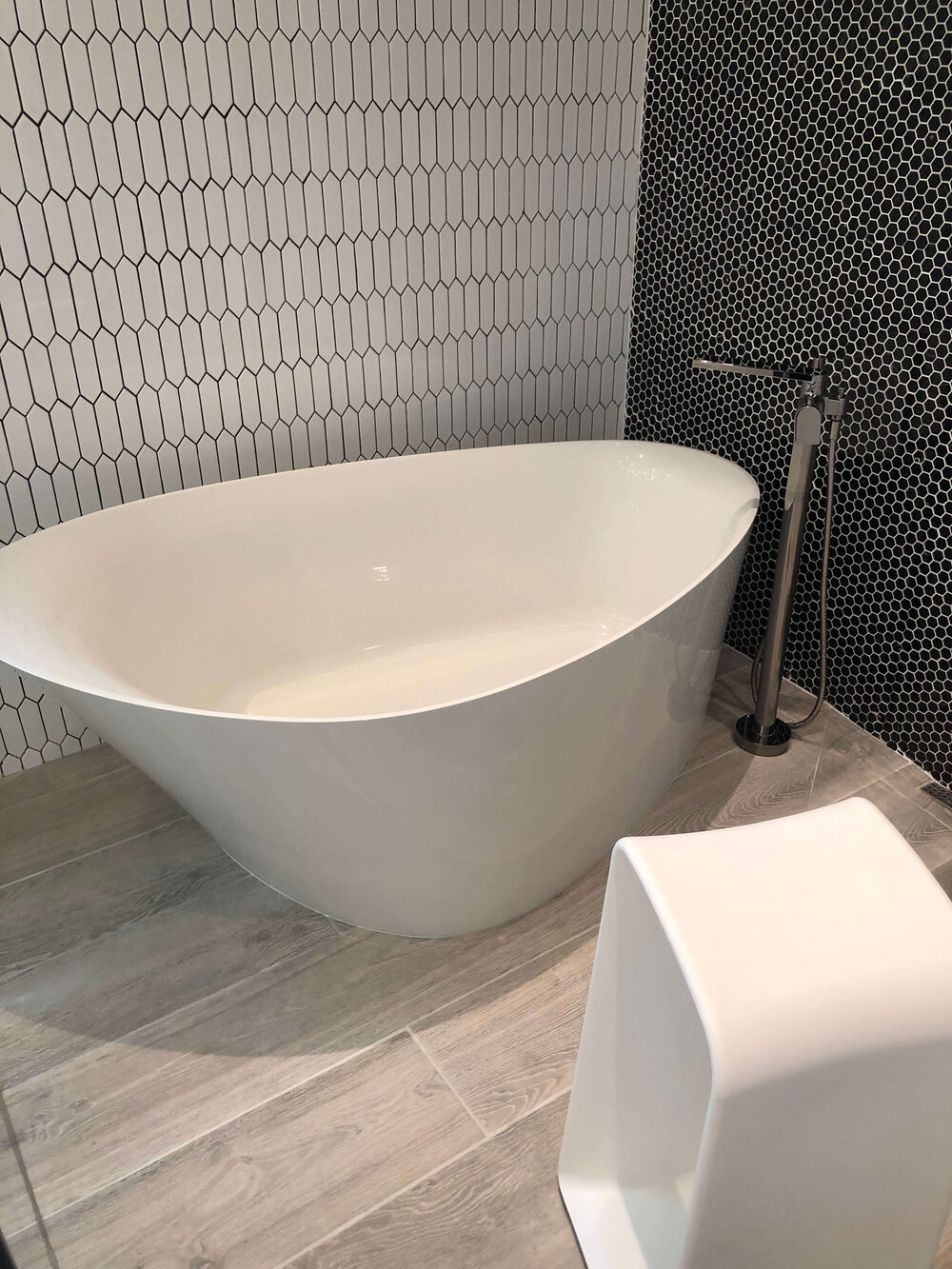 Free standing tub placed in large shower stall in The New American Remodel. TNAR | #remodeling #remodel #masterbathideas