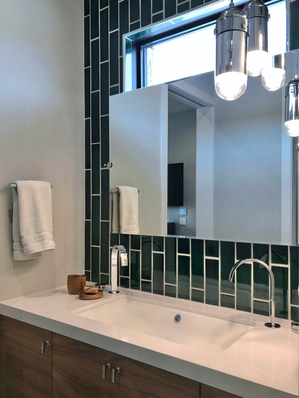 One extra wide sink with two faucets for dual use in a small vanity. The New American Remodel TNAR | #remodeling #remodel #bathroomdesign