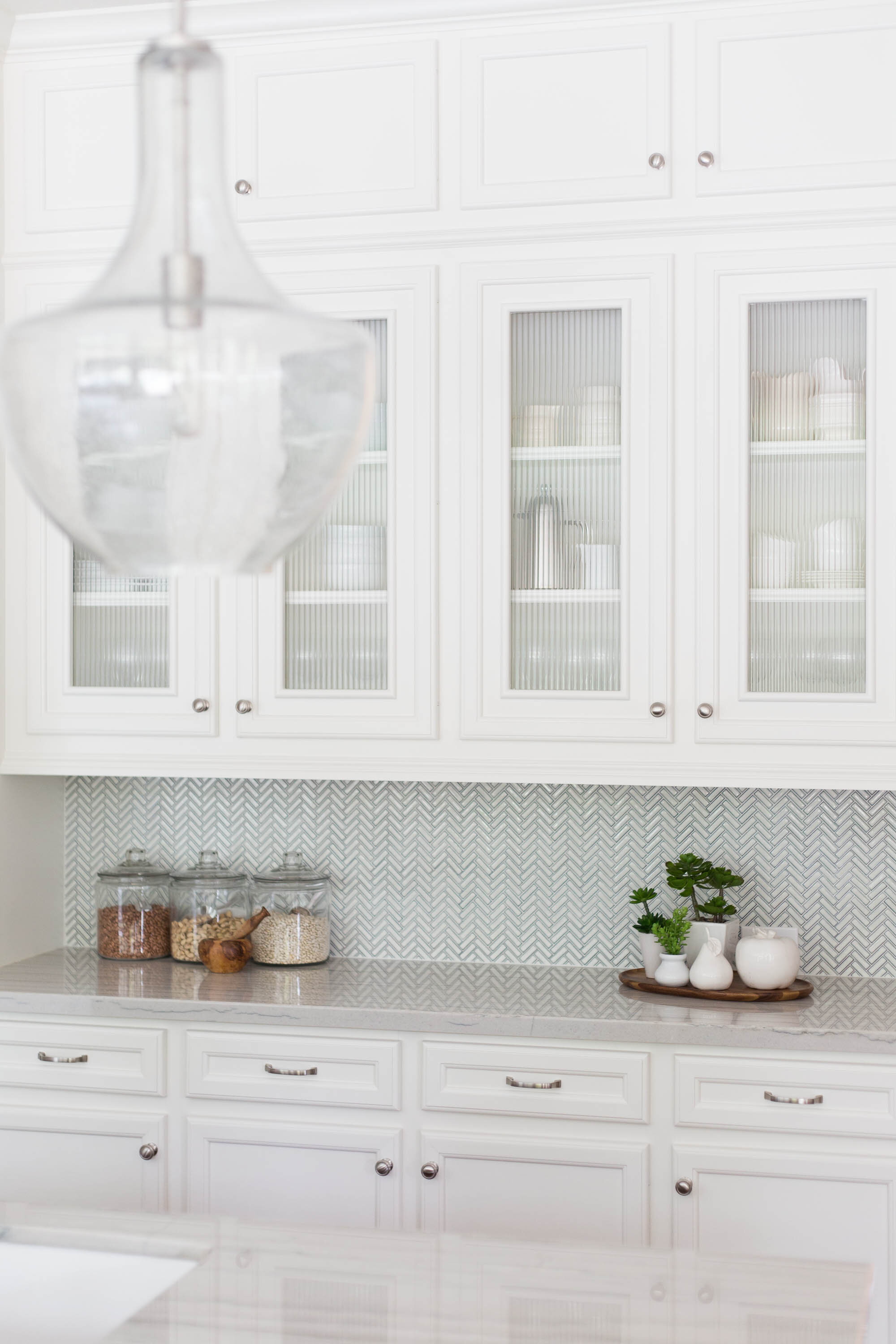 How To Style The Glass Cabinet Doors In Your Kitchen Designed