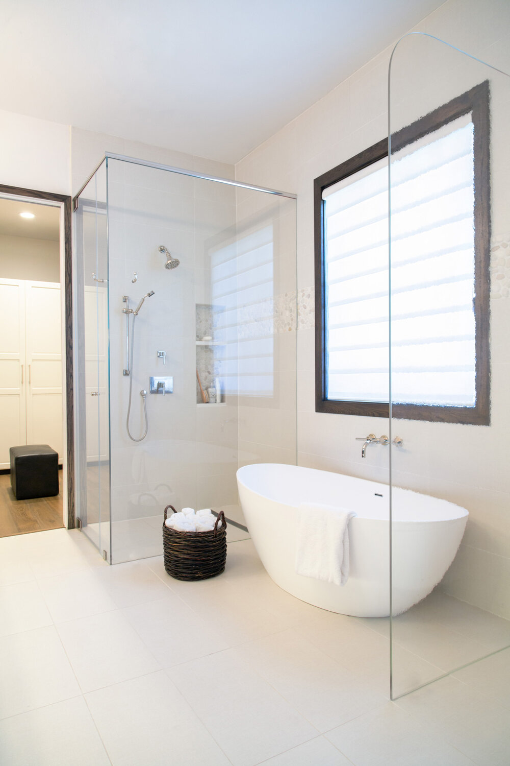 A free standing tub takes up less visual space than a built-in tub with a deck and is often why I recommend them for smaller bathrooms where more space is desired. Carla Aston, Designer | Tori Aston, Photographer
