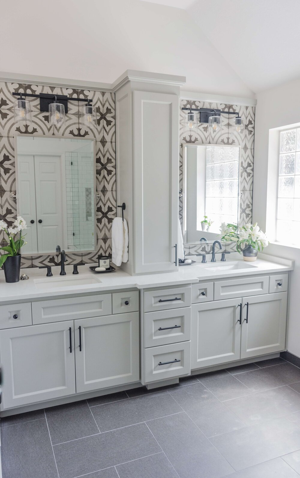 AFTER - This remodeled bathroom's double vanity is 8' wide with a tower cabinet in the middle. Carla Aston, Designer | Charles Behrend, Photographer