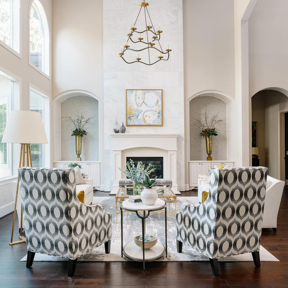 Great room seating group with two high backed chairs facing the fireplace. Carla Aston, Designer | Colleen Scott, Photographer