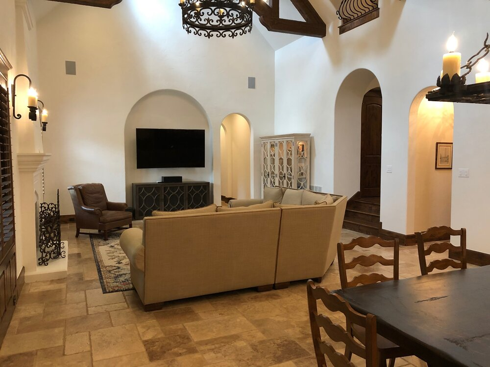 Large, open Tuscan style great room with dining area.