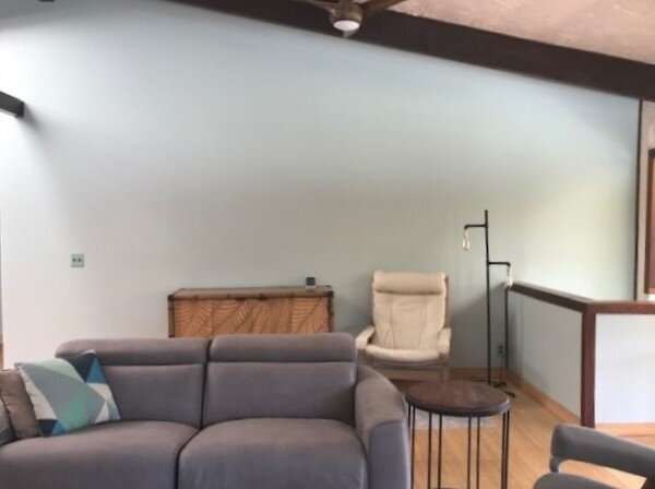 Living room with a big blank wall that needs something.
