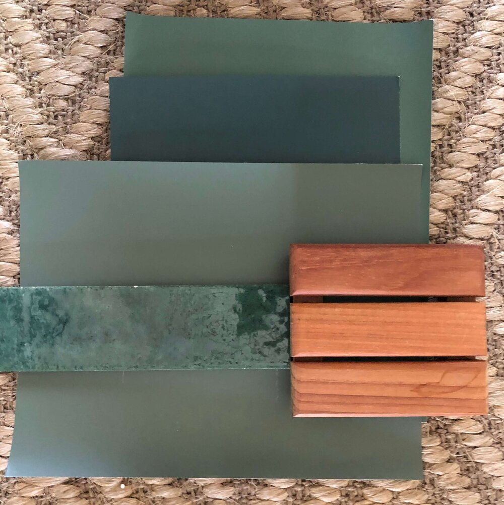 A dark green tile selection paired with wall color to match and wood cabinetry.  carlaaston.com