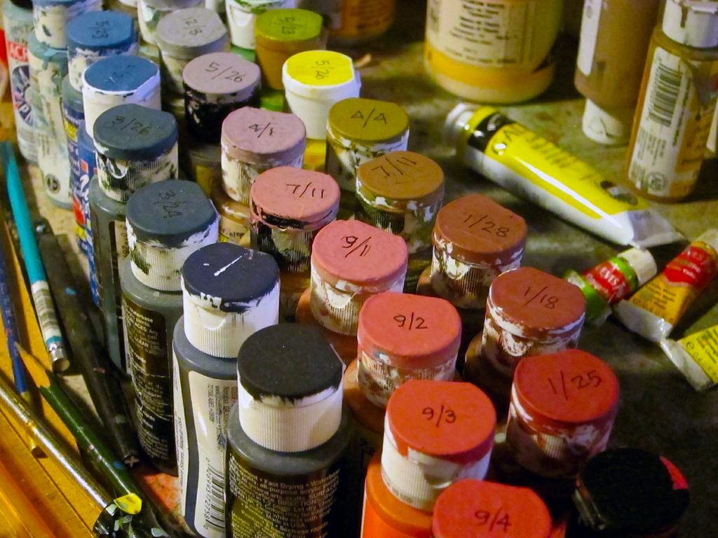 Organized paints, with the colours and dates indicated on the cap.
