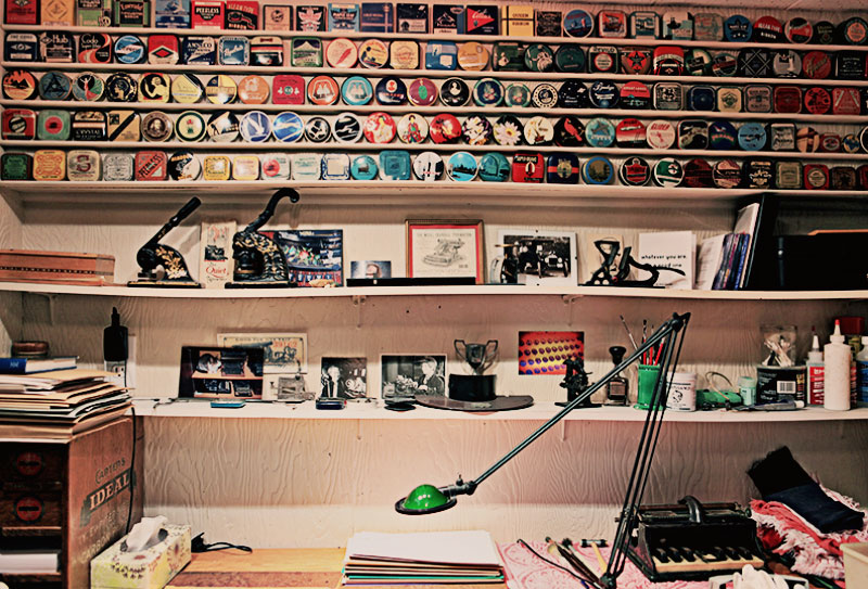Martin's display of typewriter tins above the workstation where he cleans and repairs his machines.