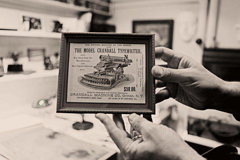 In addition to machines, Martin has an extensive collection of artifacts, like this advertisement for the Crandall Typewriter.
