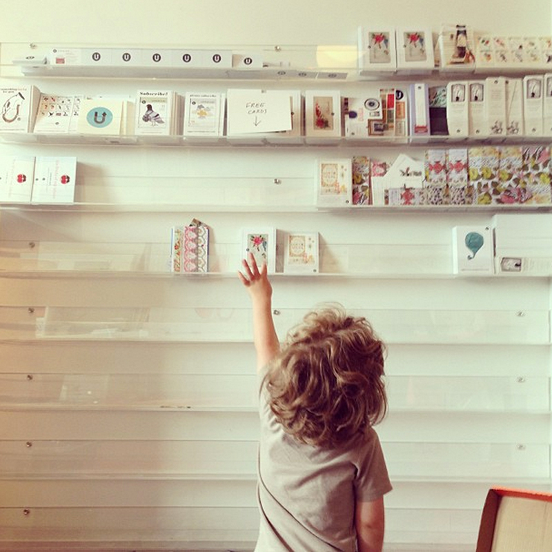 I have many photos of Finley in front of the wall of cards, measuring his growth by which rack he could reach.