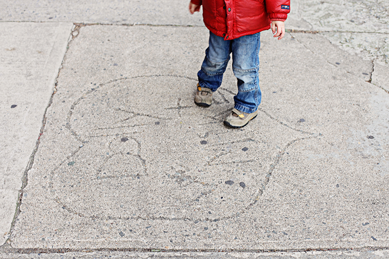 Finley pauses to notice things like broken flower pots, rocks, rough patches on the sidewalk—and hearts.