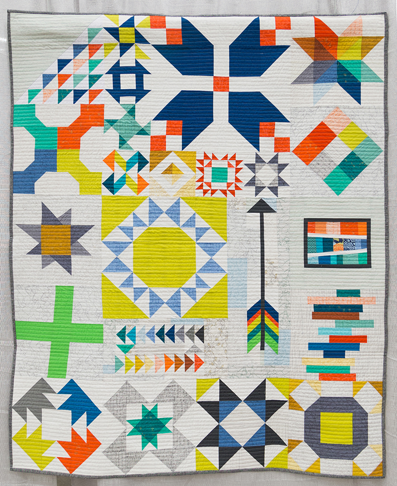 """Modern Traditionalism:1stPlace winner """"Long Island Modern Sampler"""" Pieced & Quilted by: Kim Soper from Centerport, New York. Image courtesy the QuiltCon website."""