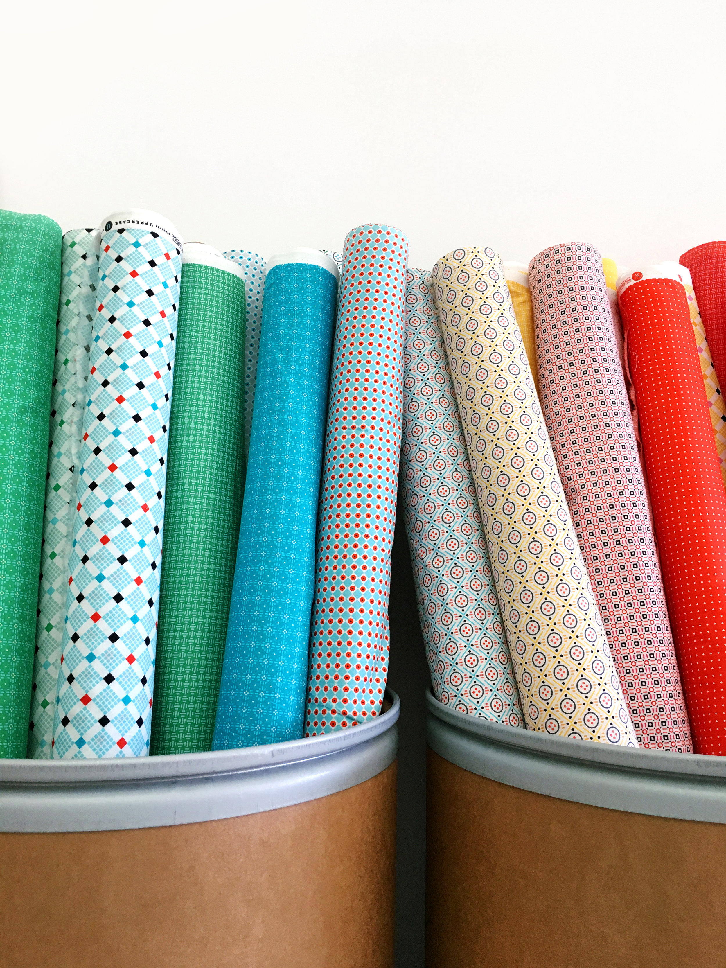 Fiber drums purchased online from Uline.ca were the perfect solution for storing 32 bolts of fabric!