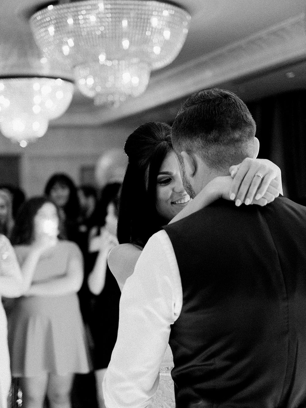 Lauren + Bradley in the moment during their first dance at Orsett Hall.