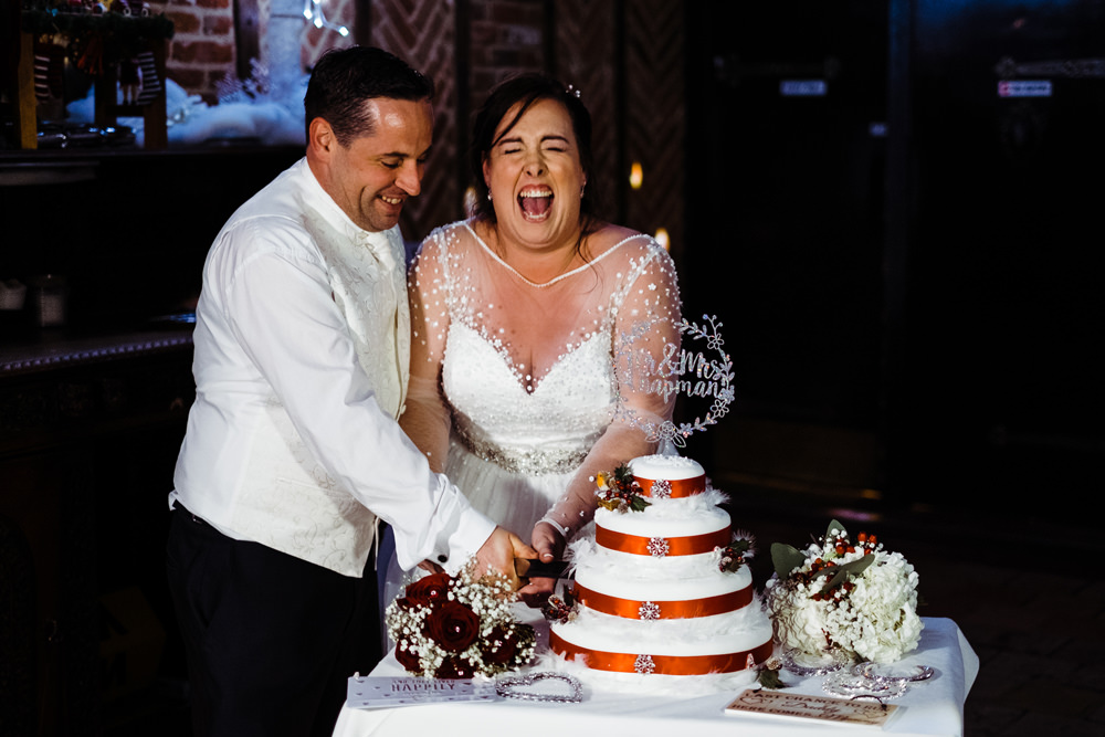 bride-groom-happy-celebrating-cutting-cake.jpg