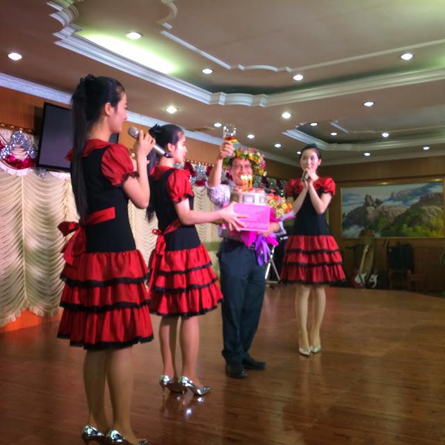At Pyeongyang Restaurant  , Phnom Penh, Binh gets a birthday surprise from the North Korean waitresses  !