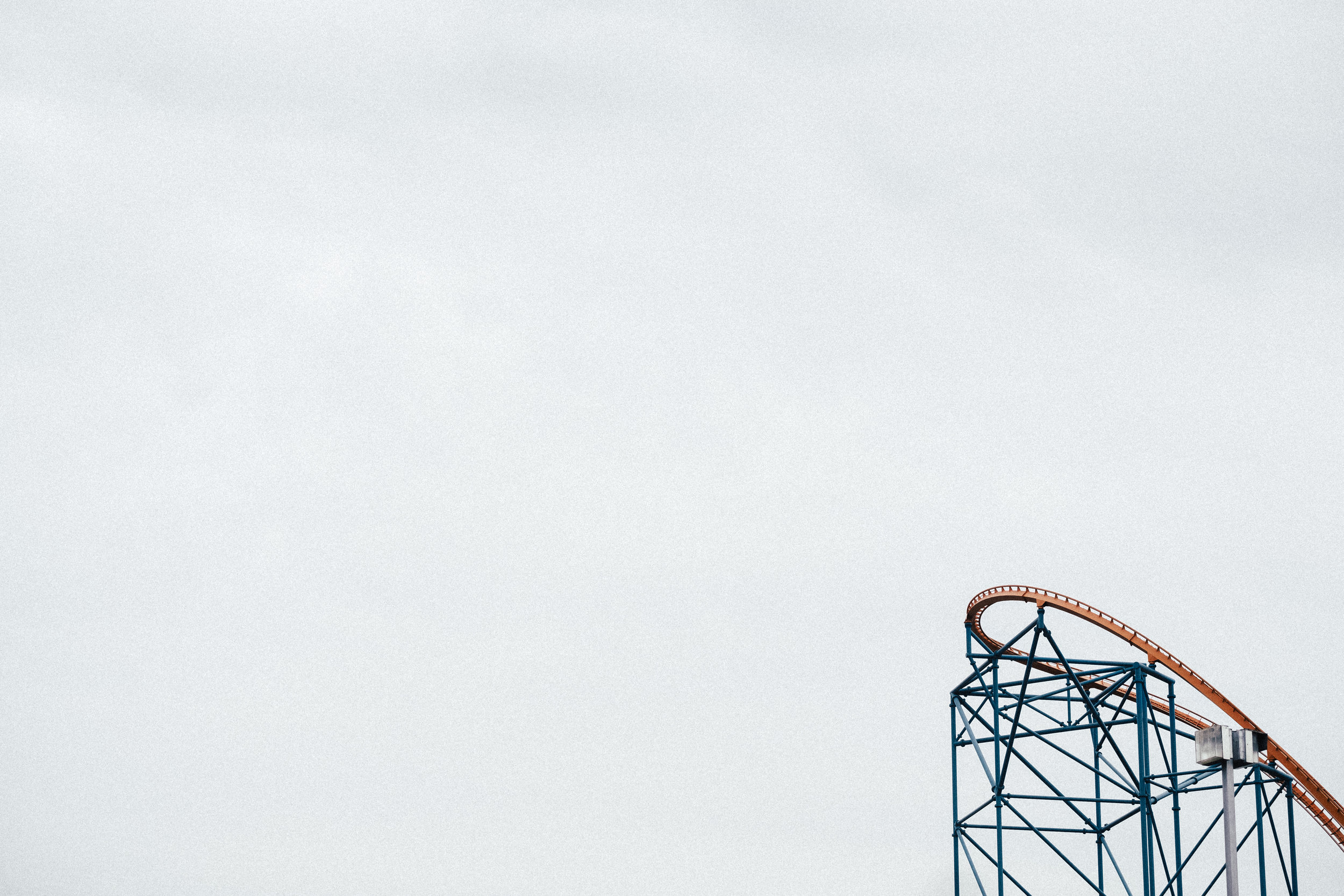 "Another example of the use of negative space, and color. This was basically a ""grab shot"" from Magic Mountain. (I strongly prefer photographing roller coasters vs. riding in them, I decided). 50mm f/4, ISO 200, 1/950s"