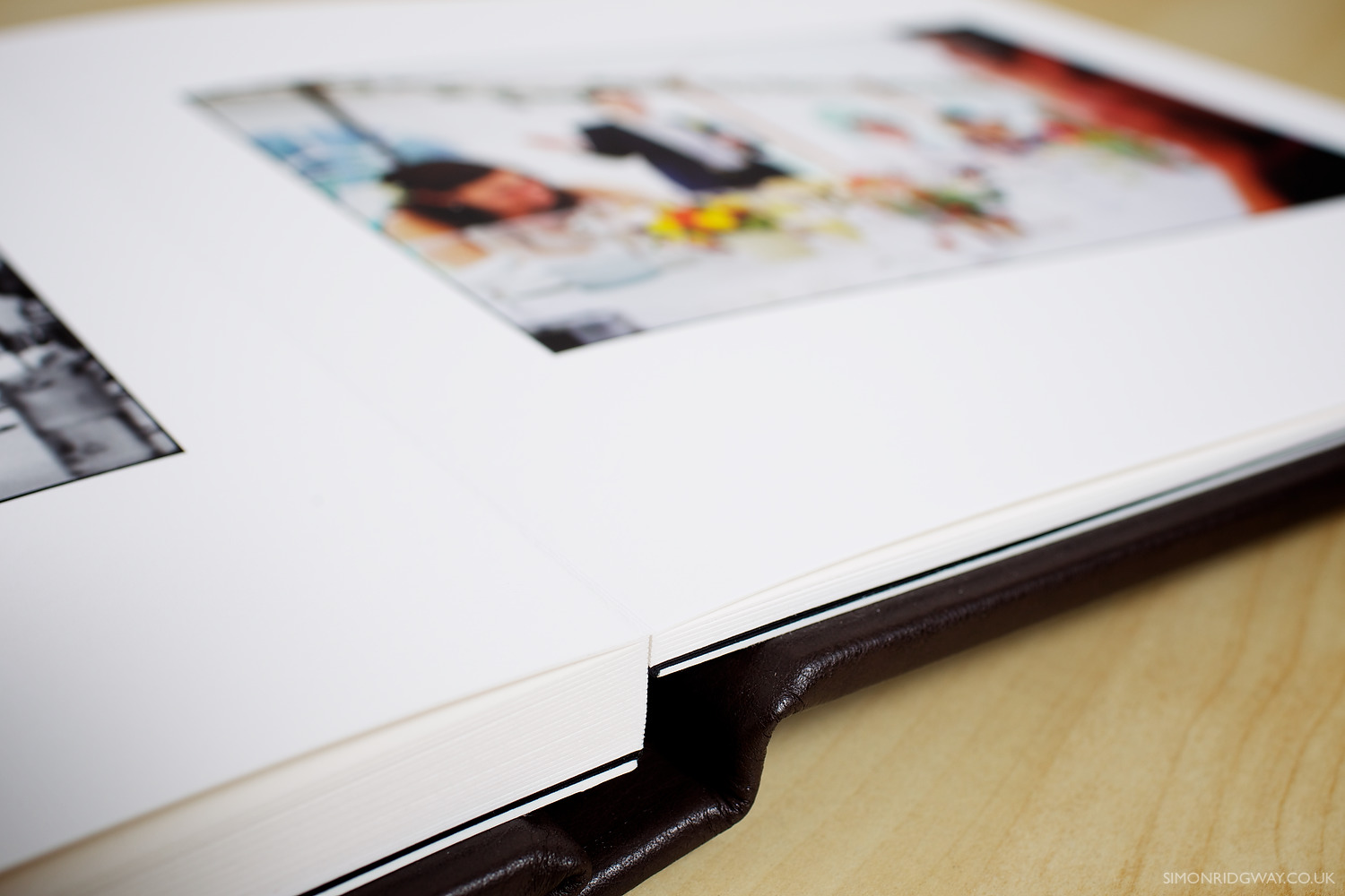 Each page consists of two paper pages glued back to back with a lay-flat binding