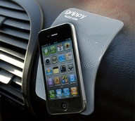 a grippy thing for my car. mostly because i want my phone to defy gravity like this one does... $7.00 whoo hoo!