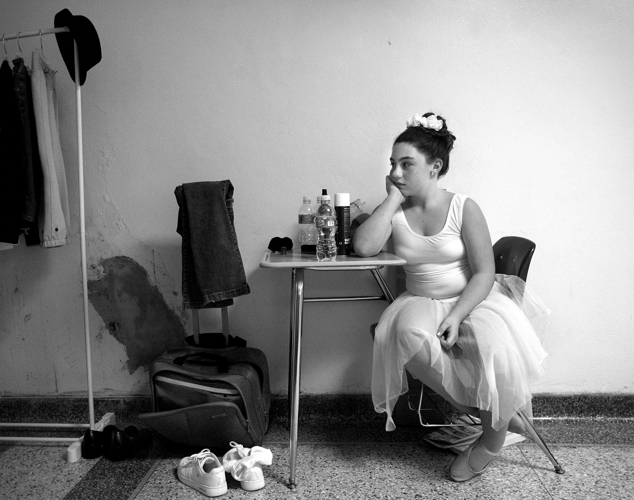 "Taylor Bramblett of Hannibal, Mo. waits near her basement ""dressing room"" in the hallway of Hannibal High School after performing a dance number in the Miss Pre-Teen contest held in conjunction with the Miss Hannibal contest."