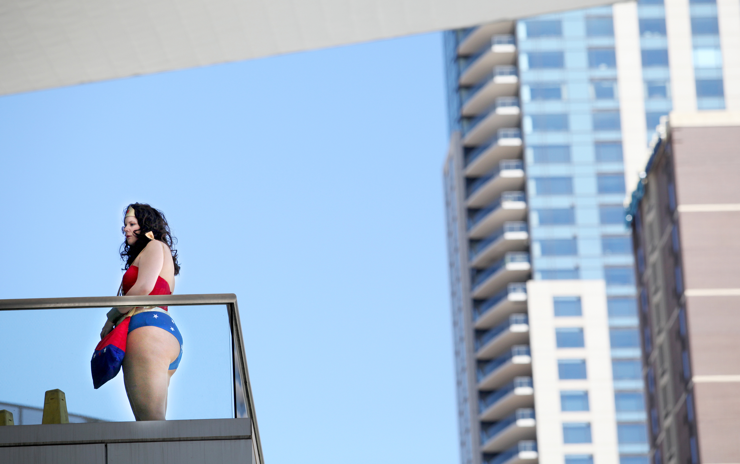 A woman dressed as Wonder Woman steps outside on the balcony of the Denver Convention Center where lovers of super heroes flocked for Comicon.