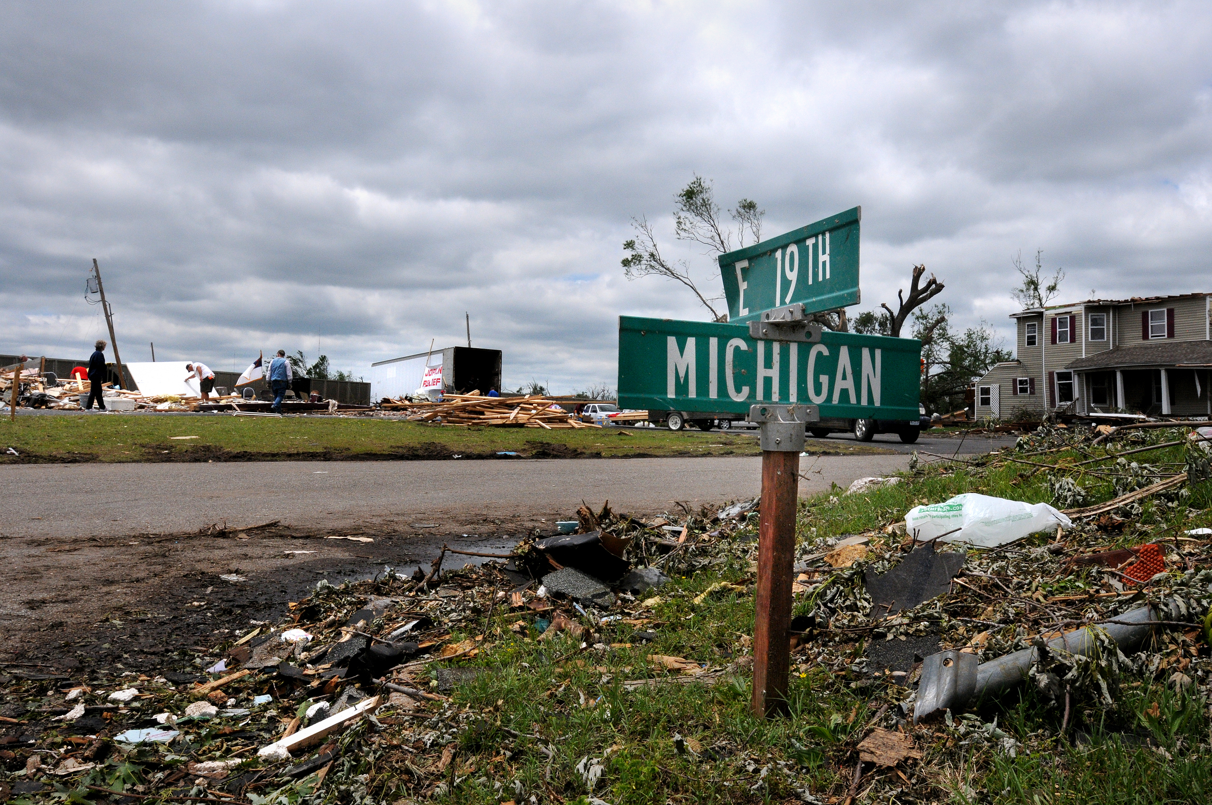 A Joplin, Mo. street sign is stuck in the ground to help identify the location after an E5 tornado destroyed most buildings, streets and signs that indicated locations.