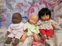 """Eastie"" (center) with the two new dolls."