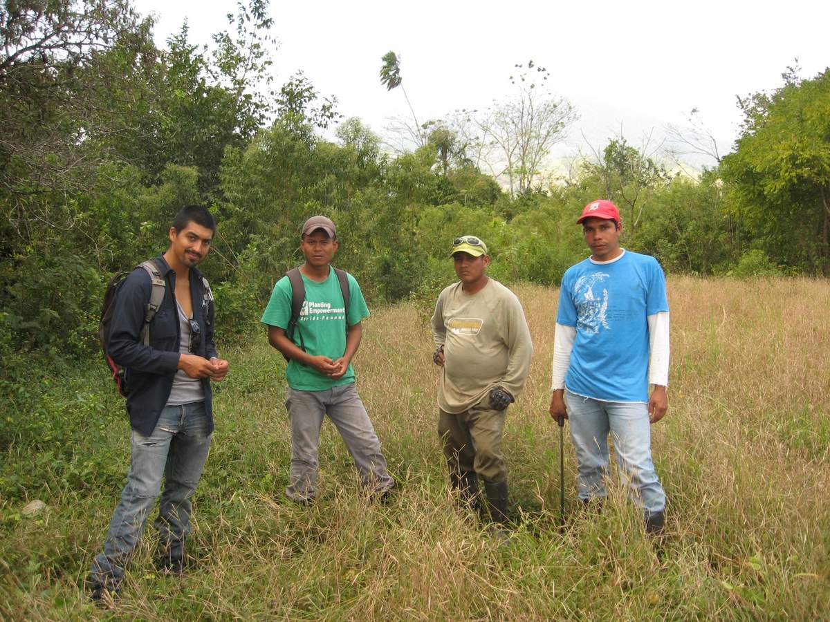 Planting Empowerment employees discuss a plantain project in Nuevo Paraiso