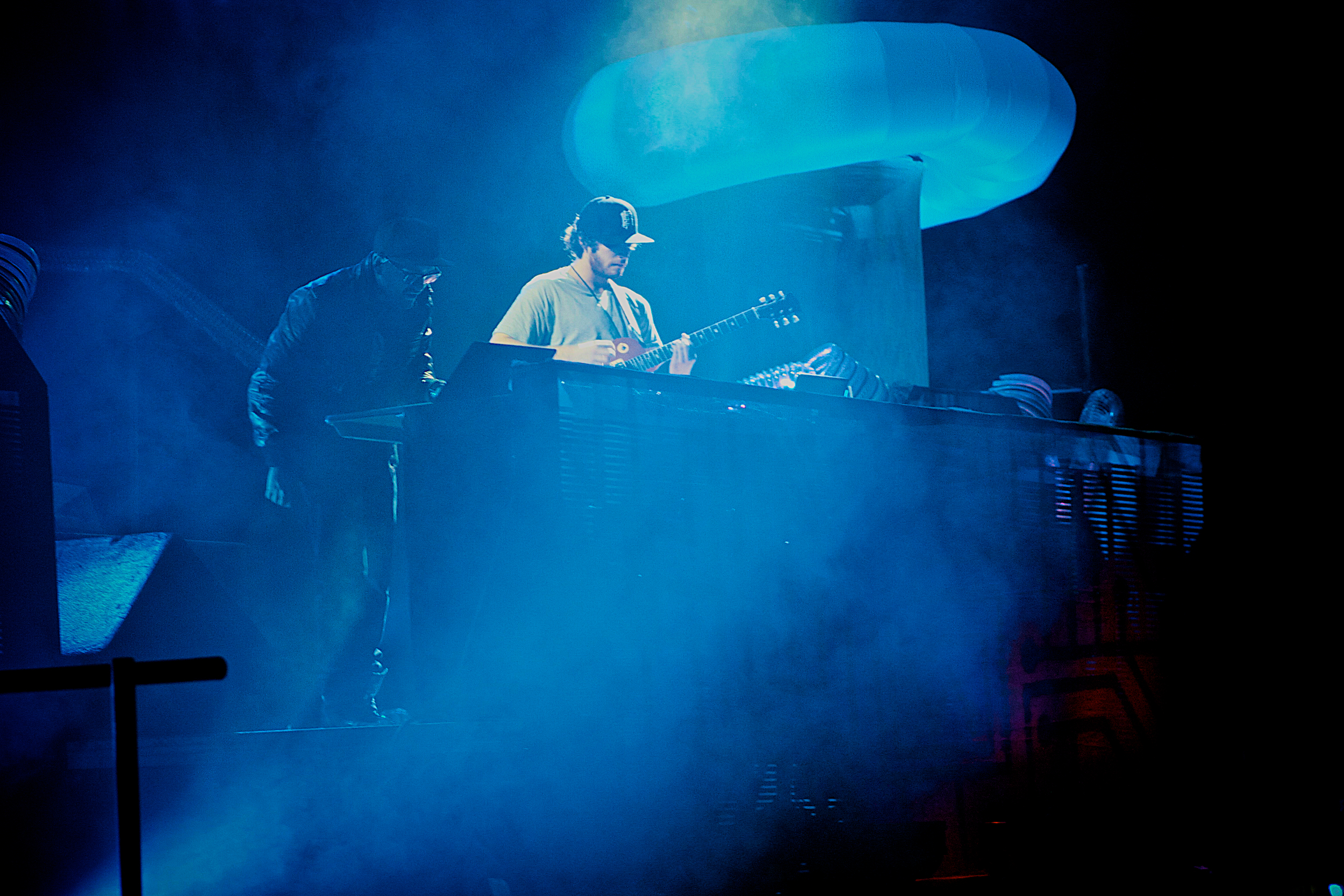 """Gramatik dropping beats flanked by """"The Coil"""" (Photo Credit: Robert Castro)"""