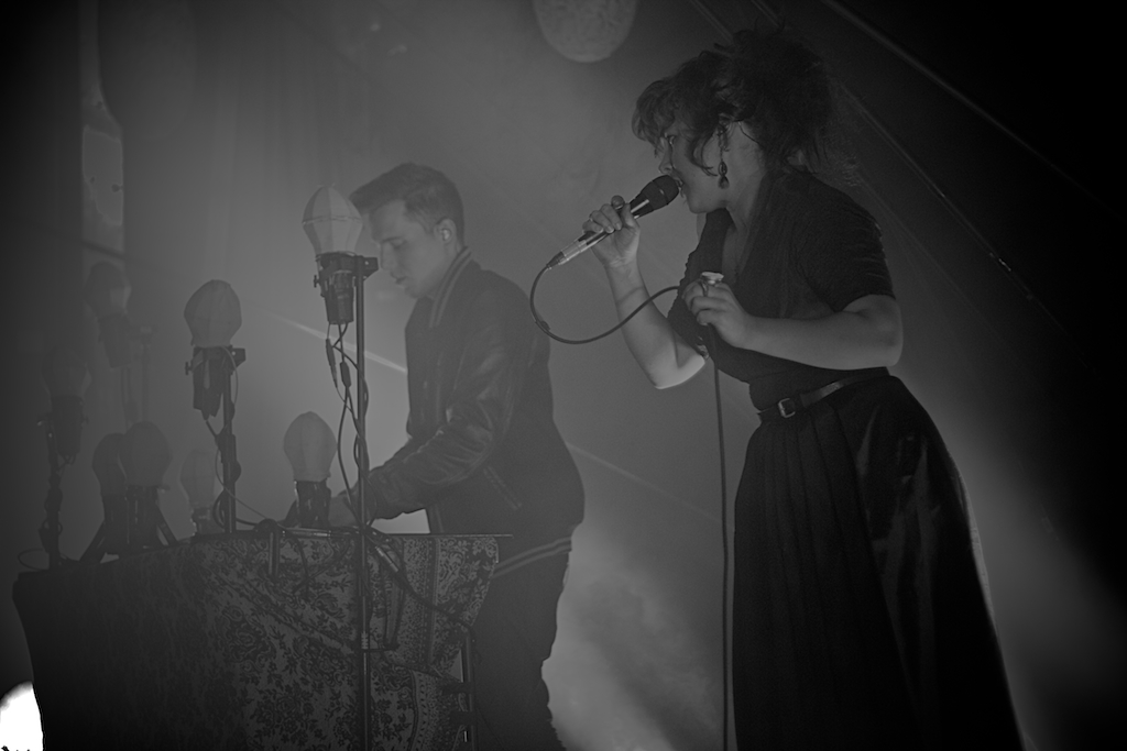 Canadian duo Purity Ring rocking The Gothic Theatre crowd. (Photo Credit: Robert Castro)