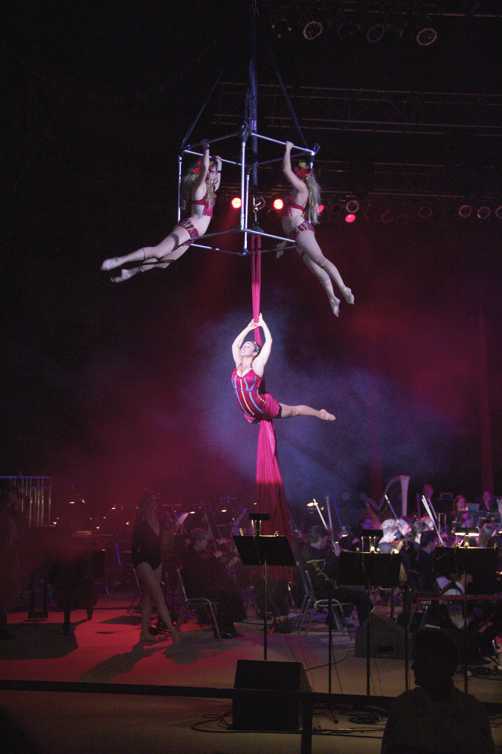Acrobatic dancers take to the sky during DeVotchKa's set last Friday night.