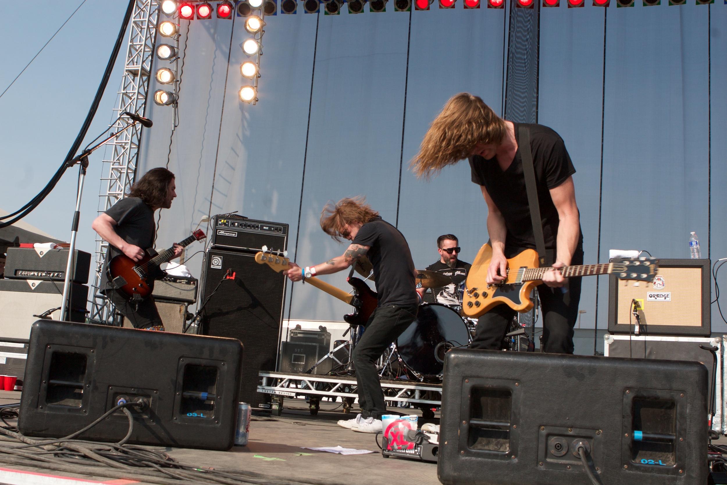 Desaparecidos rocking out. (Photo Credit: Matt Smith)