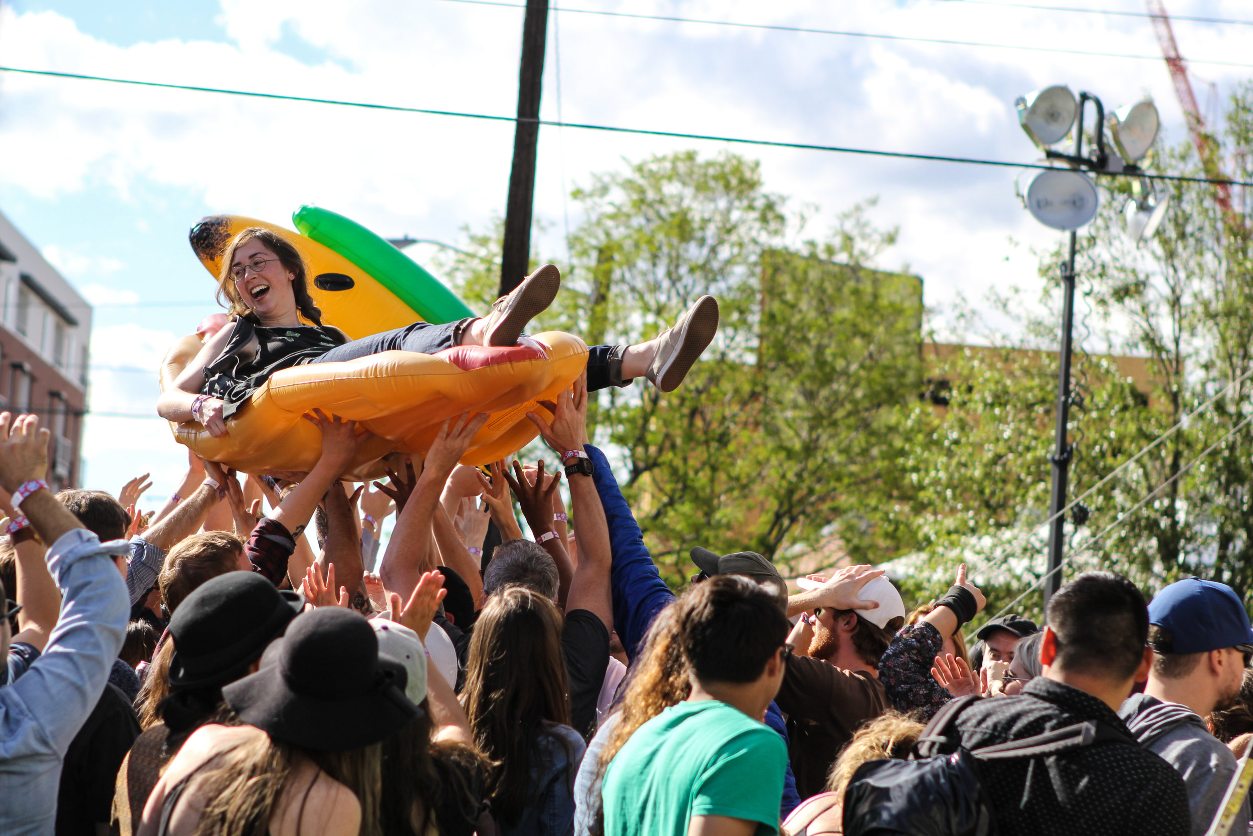 Crowd surfing on a pizza is on our bucket list (Photo Credit: Robert Castro)