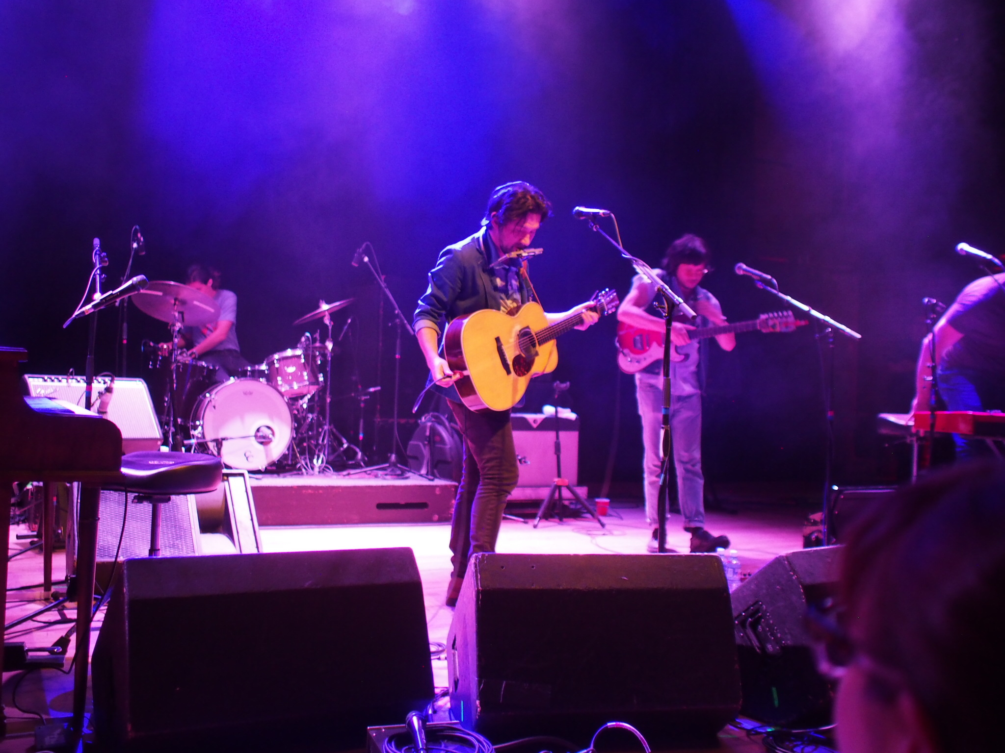 Conor Oberst switching out his guitars at Boulder Theater, 1 July 2017. Photo: Jocelyn Rockhold