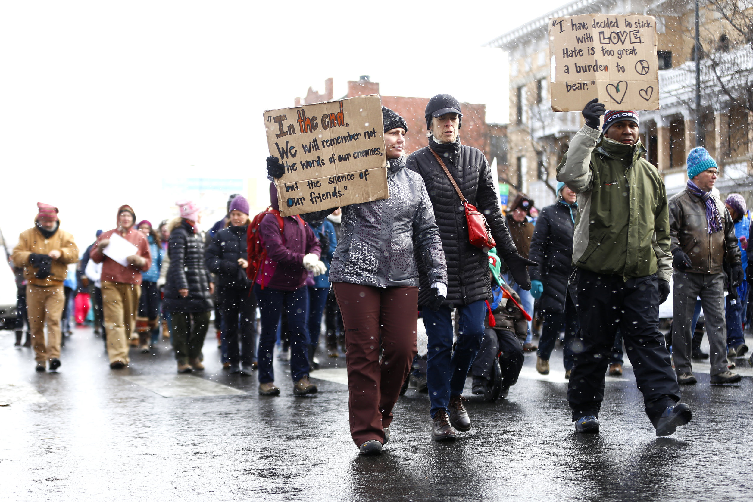Crowds braved the elements during this mornings march. (Photo Credit: Aly McClaran