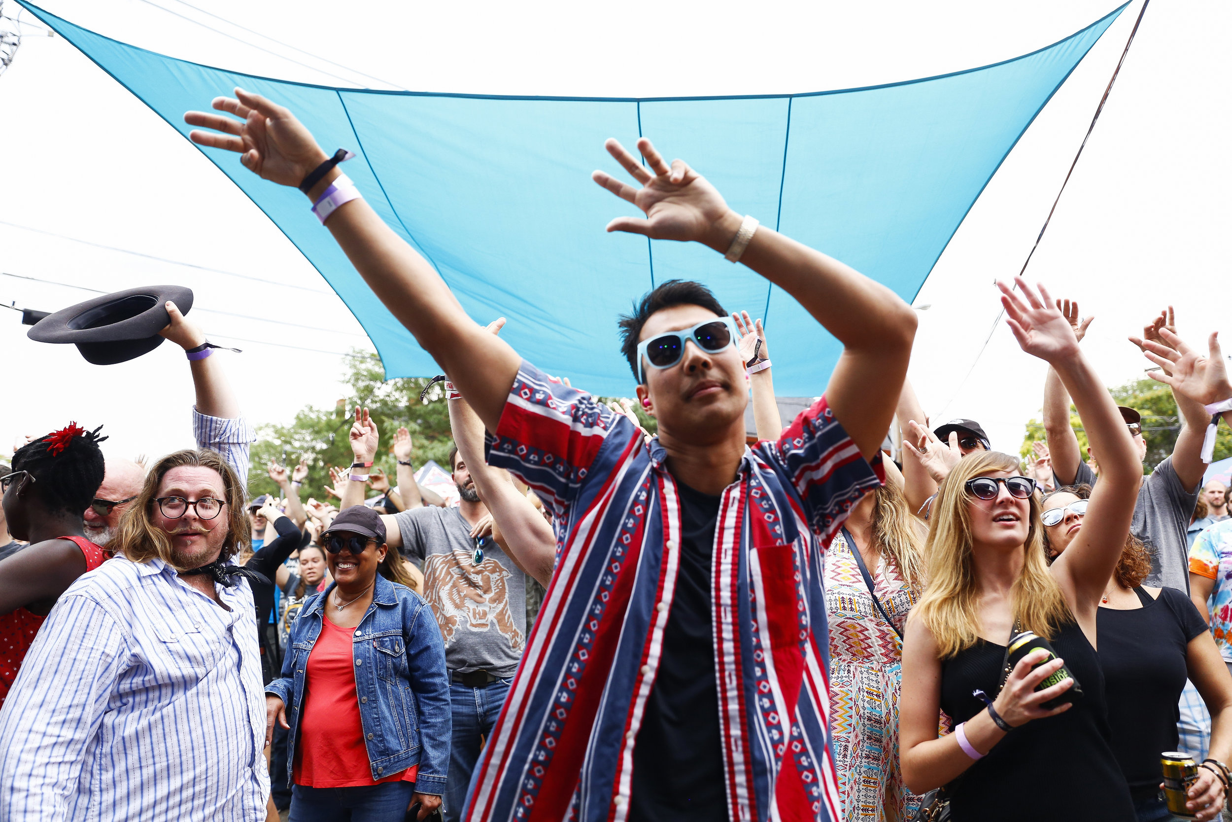 The crowd is high energy as Hot 8 Brass Band performs at Sesh Stage presented by Two Parts on July 28 at the 18th annual Underground Music Showcase in Denver. Photo by Alyson McClaran