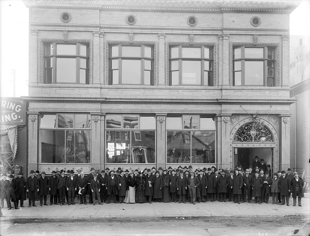 Employees pose in front of one of Denver's first newspaper buildings at 1720 Welton Street between 1901 and 1910. Courtesy of History Colorado Center.