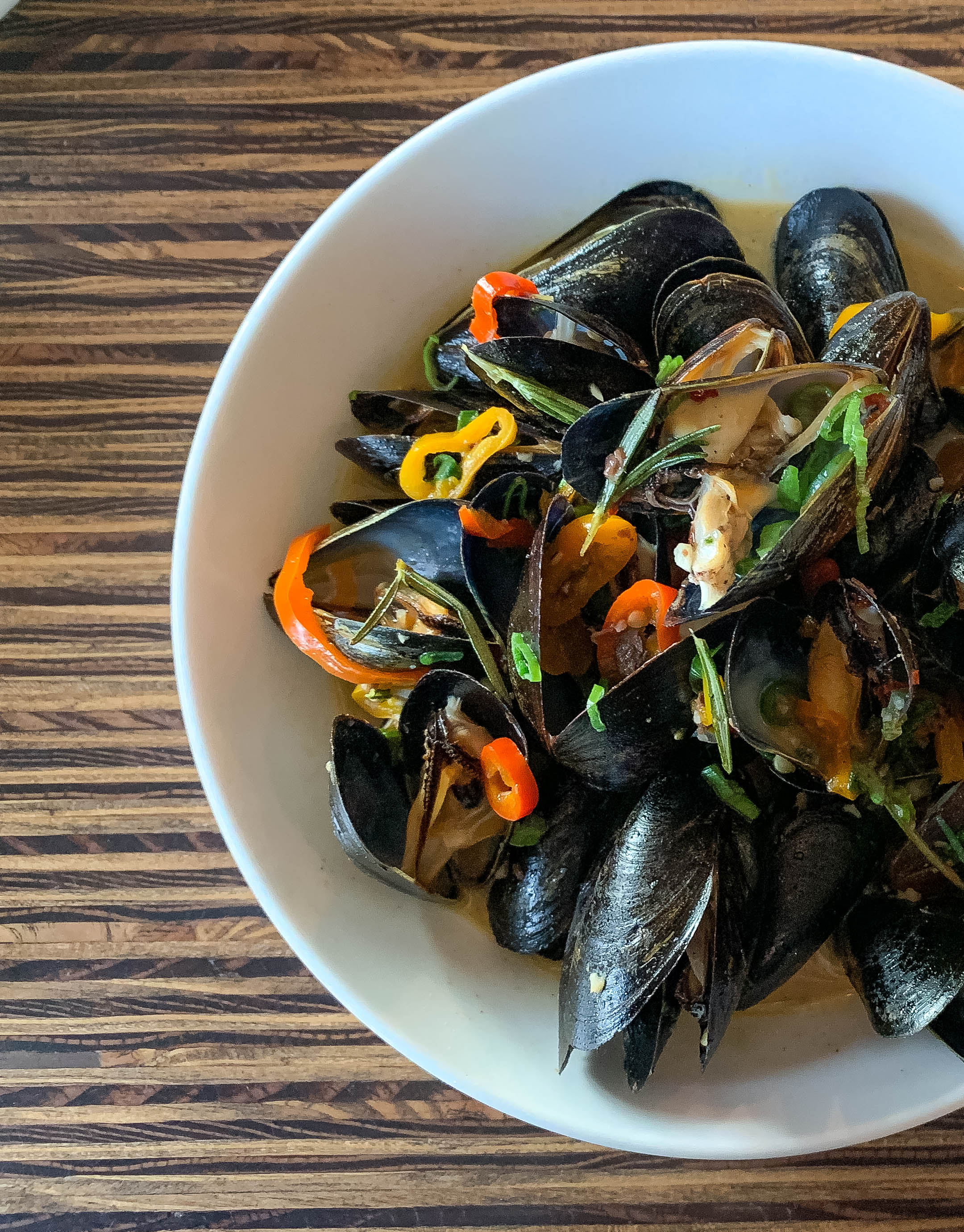 Mussels with rosemary and white wine, pickled sweet peppers, anchovy, touch of butter
