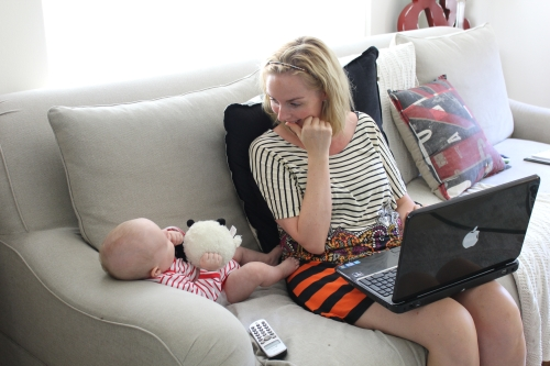 Here's the boss entertaining Rhett as she reviews something-or-other. Multitasking, I think they call it.