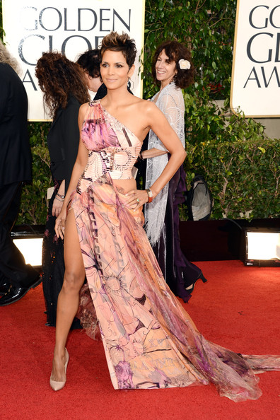 We get it Halle Berry, your body is super hot. Huge disappointment though! Dress by Versace.