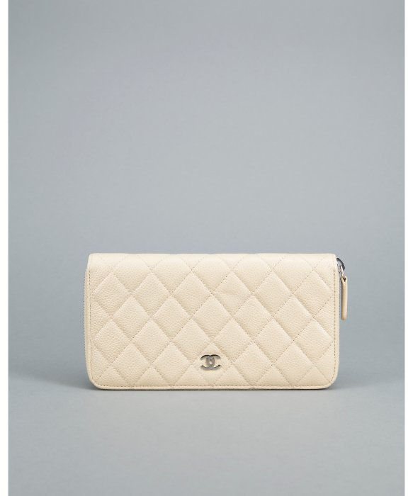 CHANEL Light Beige Caviar Quilted Zip Continental Wallet. Price:$999.00 BLUEFLY.COM
