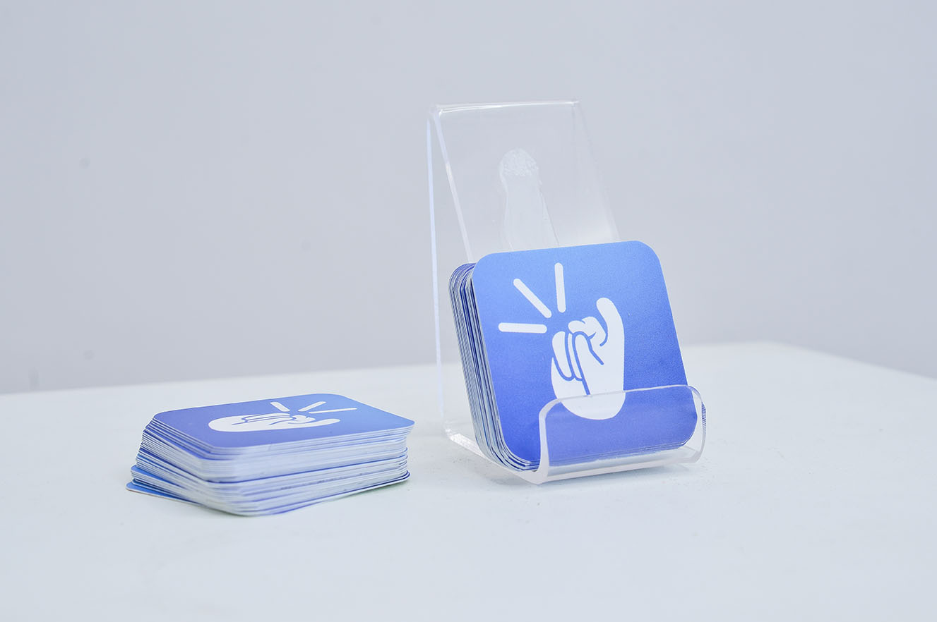 The plastic base is for placing a phone to experience the app and the cards have links and QR code for Android and iOS downloads.
