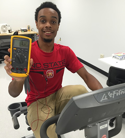 Study co-lead Haywood  Hunter,  shows off the TEG-embedded T-shirt at work.