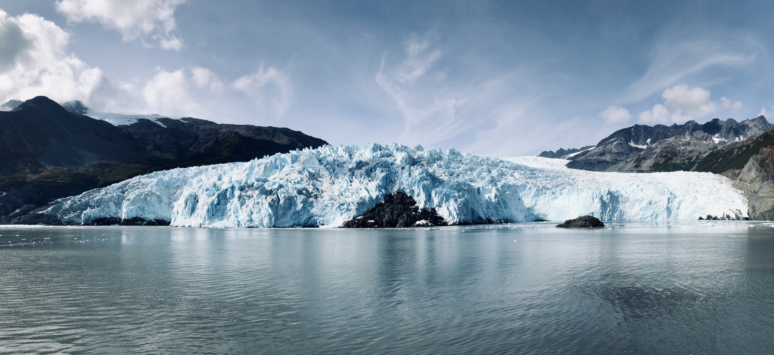 This is a super-wide angle shot. What you're looking at is a glacier that's about a mile wide and 800 feet tall.