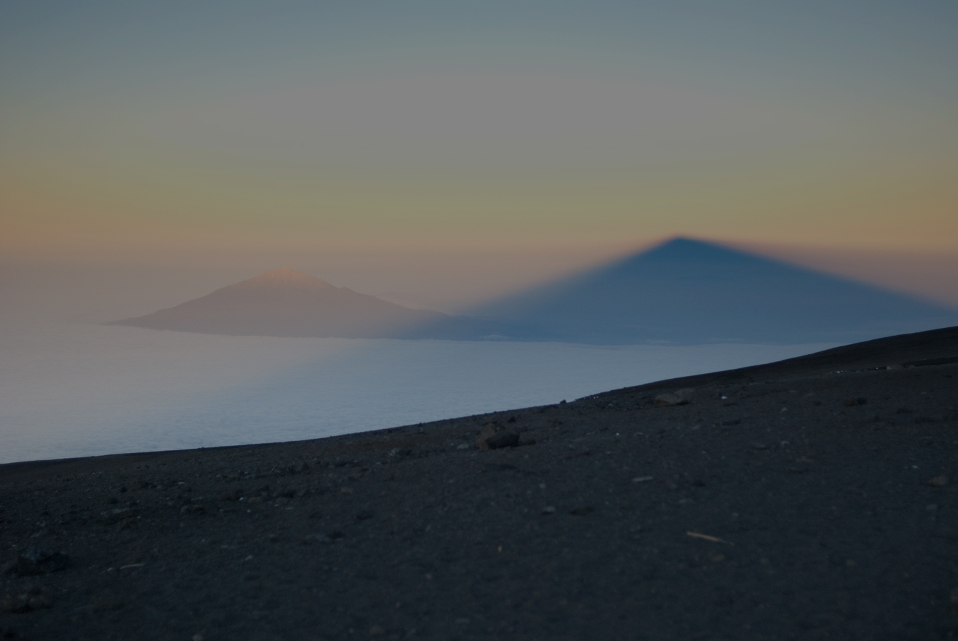 The shade of Mt. Kilimanjaro over Mt. Meru, Tanzania