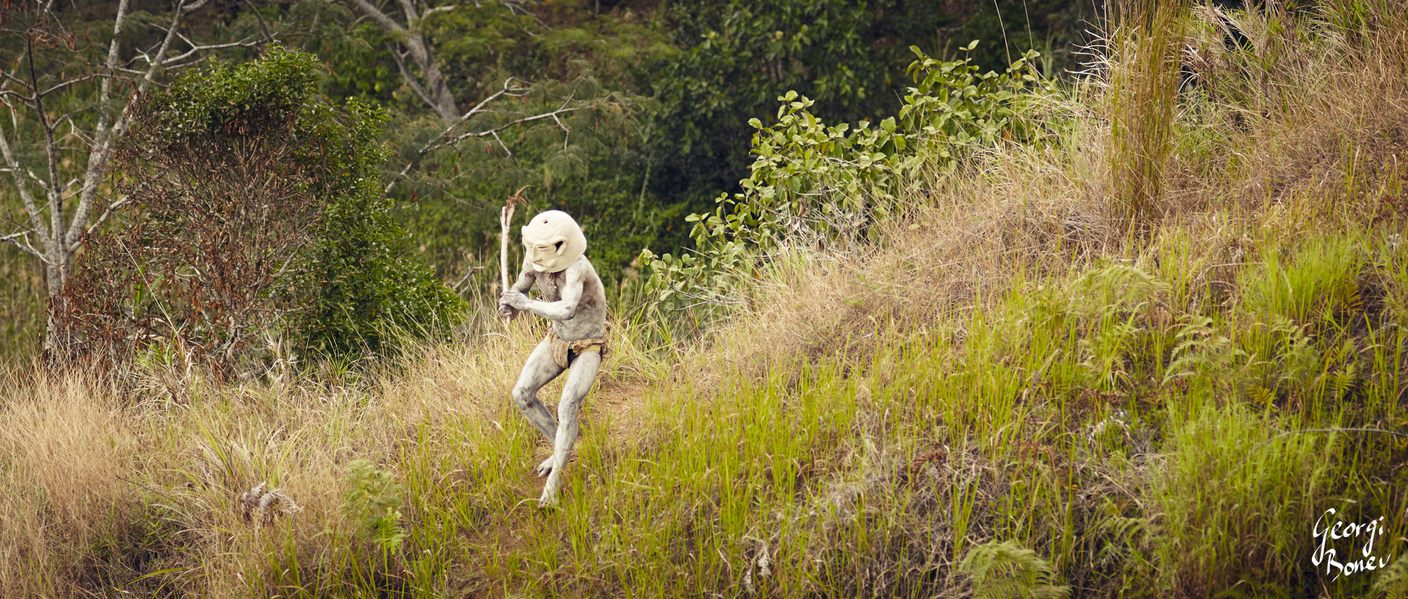 KAUPA FROM ASARO MUDMEN TRIBE APPEARING AS GHOST FROM THE FOREST IN PAPUA NEW GUINEA