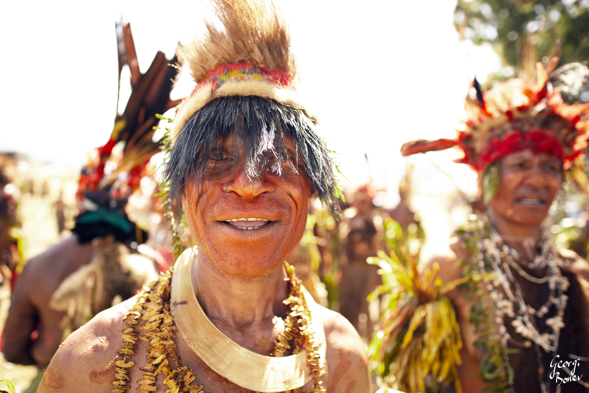 ARANGU WARRIOR WITH FACE COLLORED IN RED, PAPUA NEW GUINEA