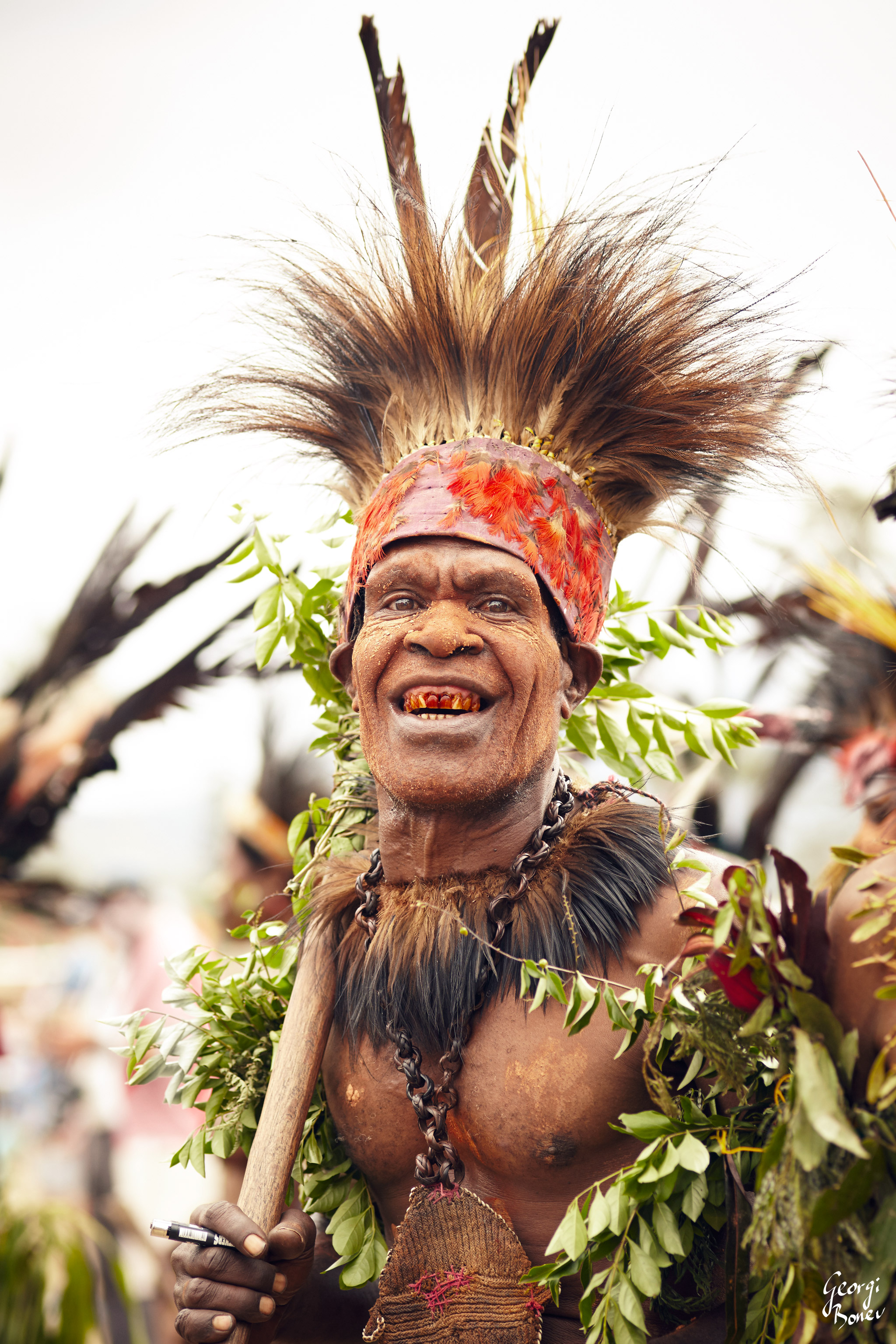 ATRIGU WARRIOR IS HAPPY TO RECEIVE A LIGHTER, PAPUA NEW GUINEA