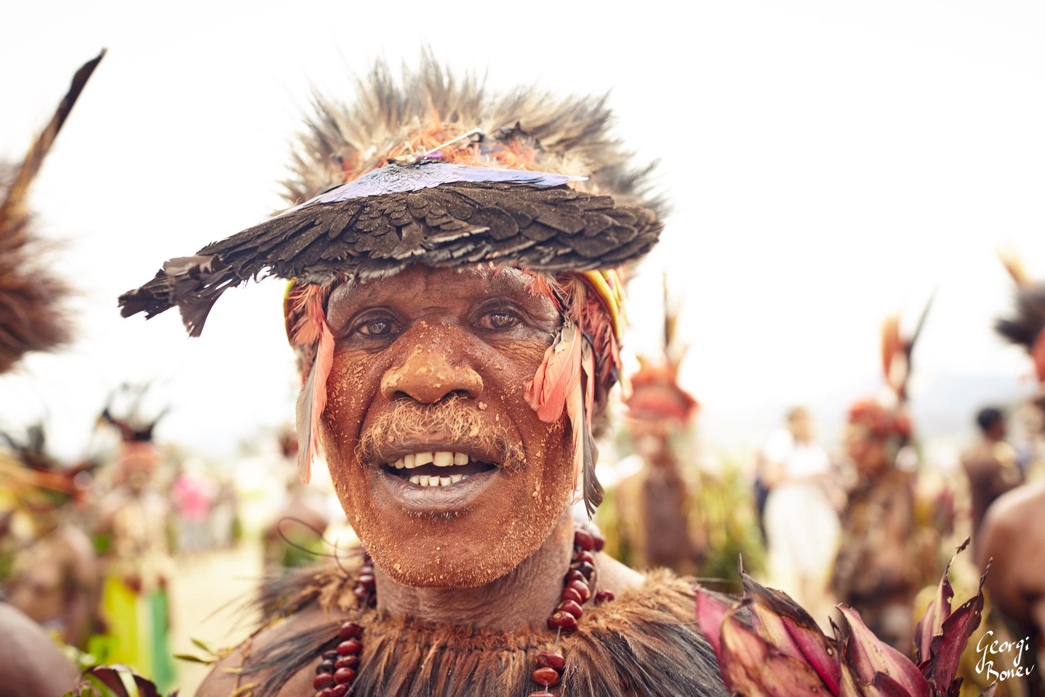 ATRIGU WARRIOR USES A WING OF A BIRD AS DOCORATION, PAPUA NEW GUINEA