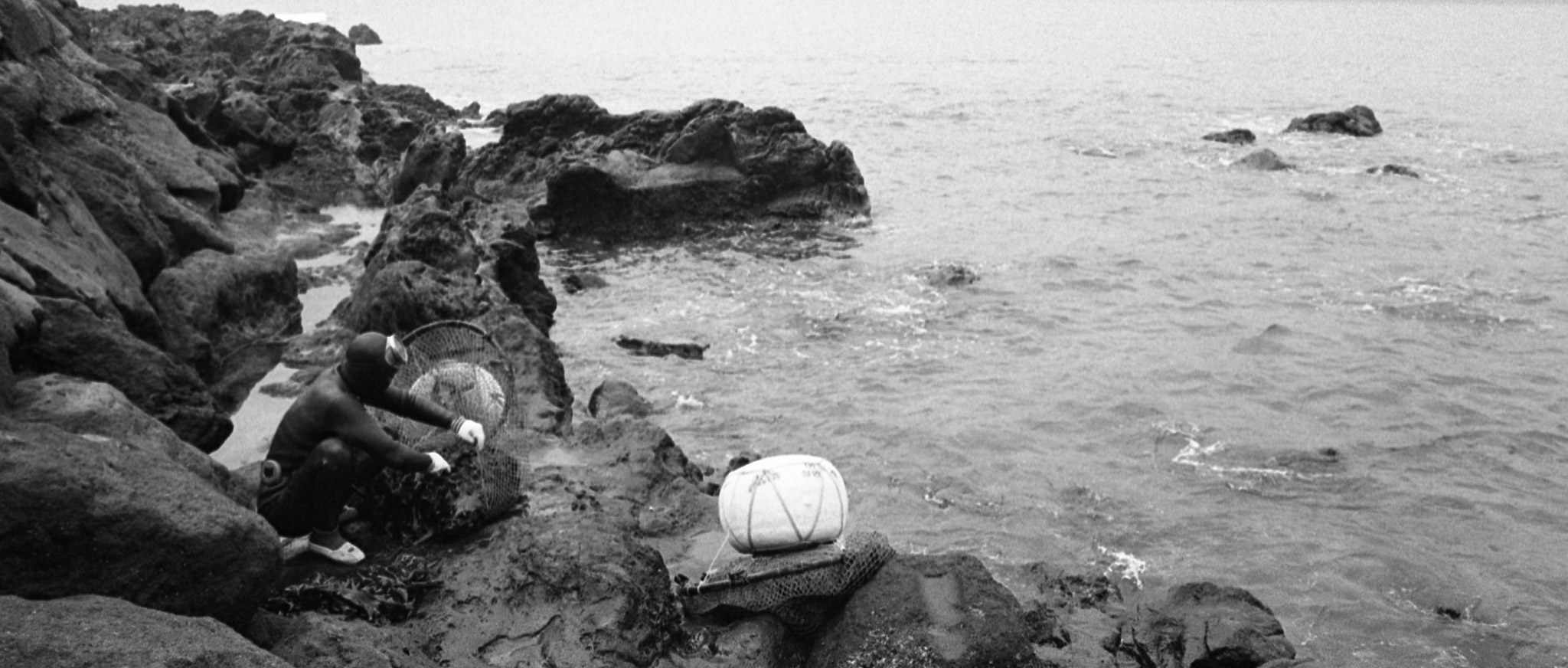 HAENYEO DIVER PREPARING TO DIVE IN JEJU ISLAND, KOREA