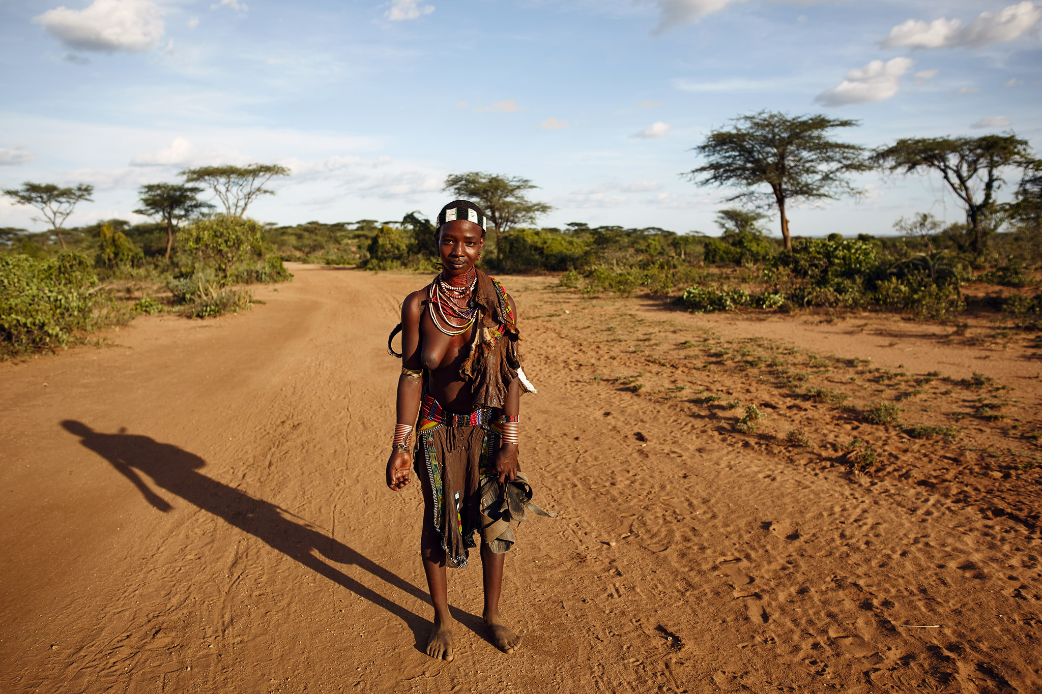 HAMAR WOMAN IN THE BUSH OF LOWER OMO VALLEY, ETHIOPIA